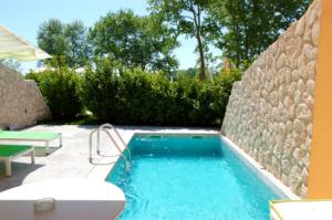 Outdoor swimming pool at luxury villa, Pieria, Greece